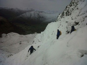 3 climbers on a steep, snowy slope, Dove Crag
